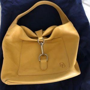 Yellow Dooney & Burke purse